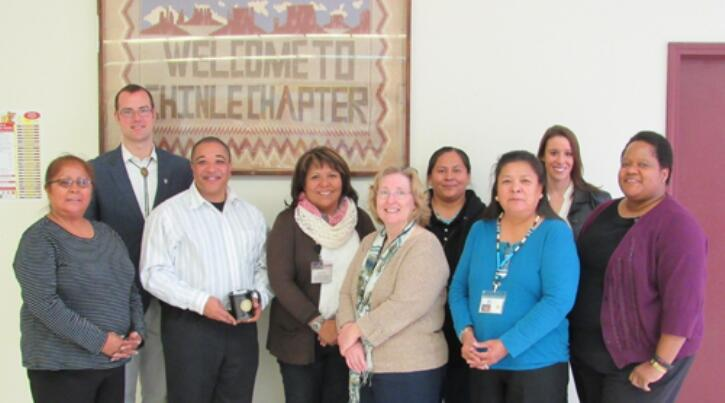 Left to right: Jarvina Lee, Navajo Uranium Workers union; Jason Bougere, DOJ attorney; Keith Williams, DOJ Claims Examiner; Luci Begay, Outreach Coordinator, Utah Navajo Health Systems; Dr. Linda Knedler, IHS Project Director; Unidentified (back row); Rena Gould, IHS Outreach Coordinator; Katherine Lloyd, HRSA; Candie Toliver, DOJ Claims Examiner.