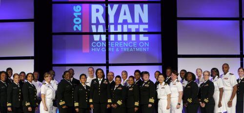 RADM Sylvia Trent-Adams with the HIV/AIDS Bureau's U.S. Public Health Service officers, standing beneath the 2016 National Ryan White Conference on HIV Care and Treatment logo.