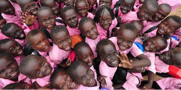 A photo of about two dozen South Sudanese children